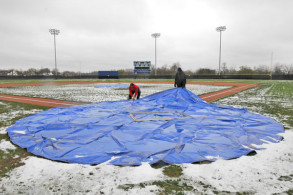 James Neiss/staff photographerNiagara Falls, NY - Sal Maglie Stadium grounds keepers Harold Nalls, left, and Roderick Page, right, keep the field dry for a scheduled doubleheader between Niagara University and Marist College at the stadium on Saturday.