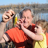 James Neiss/staff photographerSanborn, NY - Little Elise Prokop, 3, is delighted to touch the Sun Fish she caught at Bond Lake with the help of her grandfather Daniel Prokop, both of Niagara Falls, on the first day of Spring.