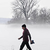 James Neiss/staff photographerNiagara Falls, NY - It was a foggy backdrop for Niagara Falls Attorney Robert Viola as he walks along the upper rapids after a Saturday morning run at Niagara Falls State Park.