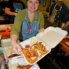 James Neiss/staff photographerLewiston, NY - Volunteer Melodie Stein of Niagara Falls knows where to get a good fish fry, as she shows off fried shrimp and battered fish fry dinners she's putting together for take out at the St. Paul's Episcopal Church Lenenten Fish Fry. The church is featuring shrimp and battered or baked fish fries for the next 4 weeks, March 9, 16, 23 and 30th.