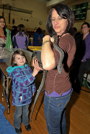 James Neiss/staff photographerNiagara Falls, NY - Who's afraid of an Australian Carpet Python? Not little Piper Penny, 5 of Lewiston and Carolyn Zito, a teachers Aid at the Lewiston - Porter Intermediate Education Center. Zito was handling the snake for a friend who brought it to the sixth annual Save-A-Pet Art Gallery show and fund raiser for the local chapter of the Save-A-Pet organization at the Intermediate Education Center.