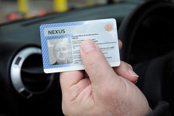 James Neiss/staff photographerQueenston, Ontario - Michael Peets of Niagara-on-the-Lake uses his NEXUS card in the new NEXUS lane just after crossing the Lewiston - Queenston bridge into Canada.