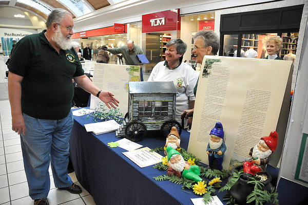 James Neiss/staff photographerNiagara Falls, NY - Arnie Nagelhout, left, Paulette Glasgow and Susan LeGasse, members of the men's and woman's Ancient Order of Hibernians, were we on hand to talk Irish history to patrons at the Fashion Outlets of Niagara during Irish Heritage Day on Saturday.