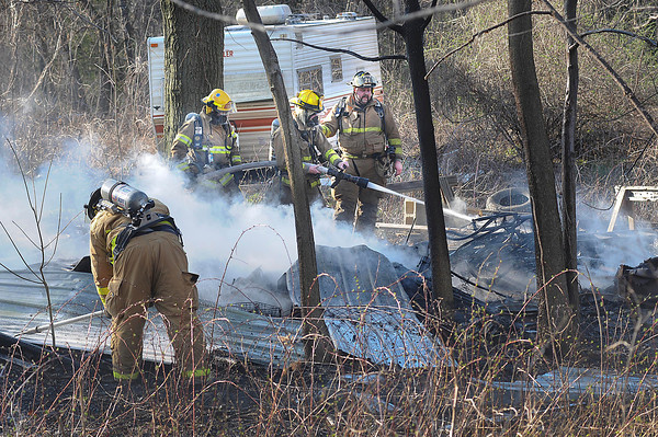 James Neiss/staff photographerSanborn, NY - Sanborn fire fighters put out a shed fire at a Mount Hope Road home on Wednesday. The building was completely destroyed.