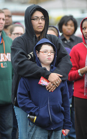 James Neiss/staff photographerNiagara Falls, NY - Rachel Rhodes and her son Angel Rosa, 9, wear hoodies and carry ice tea and Skittles at a vigil in honor Trayvon Martin at Hyde Park. Martin, on his way to a relatives after buying ice tea and Skittles, was shot by a person identified as being on a neighborhood watch patrol and claiming it was in self defence.