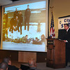 James Neiss/staff photographerNiagara Falls, NY - Mayor Paul Dyster gives praise to the Niagara Falls Fire and Police departments as he shows a Niagara Gazette photo of them in action, during his State of the City address at the Conference Center Niagara Falls.