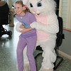 James Neiss/staff photographerLewiston, NY - Leah Plennert, 9 of Lewiston, gets her picture taken with the Easter Bunny during Eggstraviganza at The New York Power Authority's Niagara Power Project Power Vista.