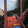 James Neiss/staff photographerNiagara Falls, NY - Cave of the Winds deck builder Travis Saturley, hammers a step into place on the first day of deck building this year. Saturley, said he prefers a little colder weather when building the decks at the base of the American Falls, because of all the clothing they need to wear that protect them from the mist. The Cave of the Winds tour is one of the most popular attractions at Niagara Falls State Park.