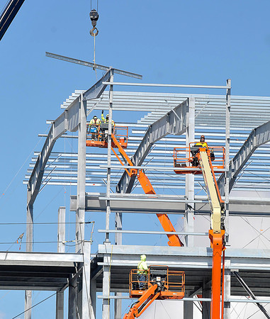 James Neiss/staff photographerNiagara Falls, NY - Steel workers steer beams into place at the Norampac Industries Greenpac Mill Project on Royal Avenue.
