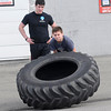 James Neiss/staff photographerNiagara Falls, NY - Michael Laurrie, 13, puts his back into lifting a gigantic tire as his personal trainer Jack Lazarus, left, monitors his progress. Laurrie, said he's lost over 25 lbs working out these last 6 months at ChrisFit Personal Training.