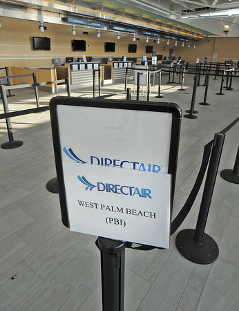 James Neiss/staff photographerNiagara Falls, NY - The signs were still in place the next day directing passengers to the Direct Air flight that was canceled without explanation Monday evening.
