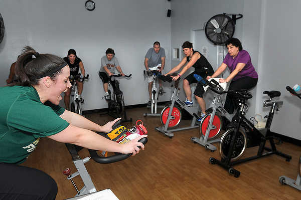 James Neiss/staff photographerLewiston, NY - Instructor Kaylin Ranagan, left, puts her spinning class through their paces. The cyclists are participating in a Tour de France theme cycling project at Niagara Health & Fitness facility in Lewiston.
