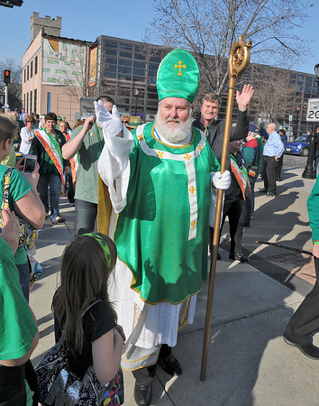 James Neiss/staff photographerNiagara Falls, NY - Arnie Nagelhout of Niagara Falls, a member of the Niagara Falls chapter of the Ancient Order of Hibernians, portrays St. Patrick as he waves to the crowd during the Worlds Shortest Parade in celebration of St. Patrick Day. The length is estimated at about 57 steps from the corner of Old Falls Street, to the front door of the Conference Center Niagara Falls on First Street where they held the 30th annual celebration hosted by the AOH.