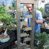 North Tonawanda NY - Gary Sokolowski of Menne Nursery shows of one of the many decorative fountains for sale at the Niagara Falls Boulevard store.