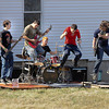 James Neiss/staff photographerLewiston, NY -  Members of the band Reperfection, from left, Jonathan Zeams, Shane Jacob, T.J. Carson, Ryan Morreale and Patrick Tierney, enjoy Wednesdays spring like weather to rock it out of doors at a home on Ridge Road. The band was practicing for their next gig.