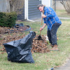 James Neiss/staff photographerNiagara Falls, NY - Tony Cheff  puts his back into it as he cleans away the winter debris from his Niagara Avenue yard on a 70 degree winter day.