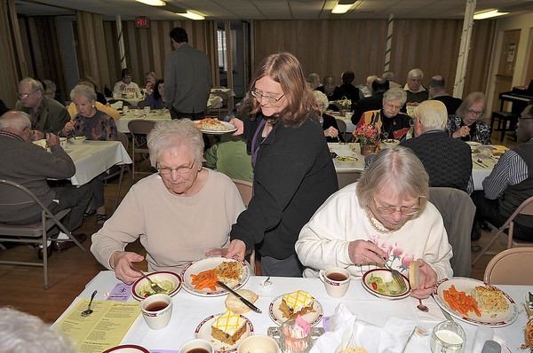 James Neiss/staff photographerNiagara Falls, NY - Volunteer Rita Horner, center, serves up some meatless lasagna to Mary Fegatilli, left, and Marge Fiacco at the First Presbyterian Church Community Lenten Lunch on Thursday. The next lunch on April 5, features guest speaker Rev. Mark Perkins and a Glazed Ham Ball entree.