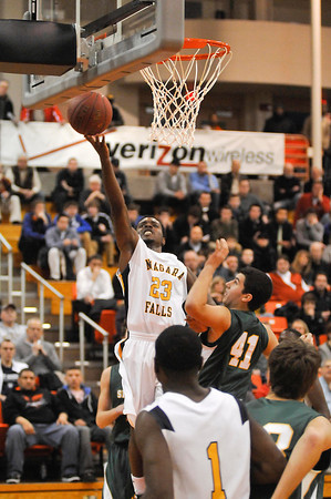 James Neiss/staff photographerBuffalo, NY - Niagara Falls High School basketball player #23 Taijay Williams puts the ball up in the first half of game action against Williamsville North in a Class AA boys basketball sectional semifinal at Buffalo State.