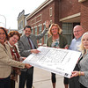 James Neiss/staff photographerNiagara Falls, NY - Family & Children's Service of Niagara staff, from left, Administrative Assistant Vicki Shane, Vice President Clarice McClure, President and CEO Kenneth Sass, Director of Finance Sara Carella, IT Consultant Kevin Ford and Director of Development Jennifer Tresch stand outside a new addition called The Niagara Family Center. The center is a collaboration of 7 not for profit agencies that will service diverse needs in Niagara County, said Sass.