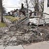 James Neiss/staff photographerNiagara Falls, NY - Debris from a fallen tree crashed into a metal railing and camper at a home on the corner of Deveaux Street and Maple Avenue. Saturdays wind storm caused city wide damage.
