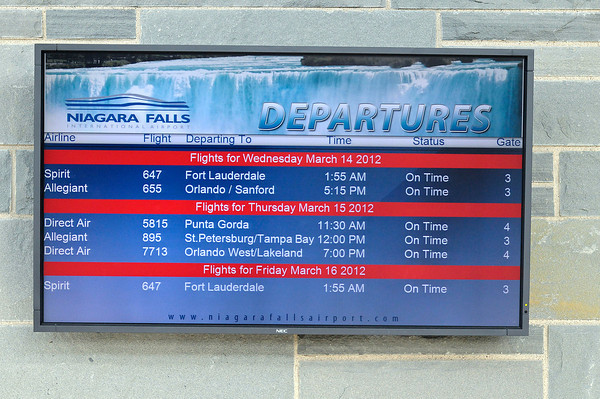 James Neiss/staff photographerNiagara Falls, NY - The departure board at Niagara Falls International Airport shows all flights on time Tuesday morning.