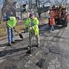 James Neiss/staff photographerNiagara Falls, NY - Pothole Killers: DPW workers, from left, Richard Harvey, Jon Fadel and Toni Manzare fill potholes with cold patch on Kies Avenue.