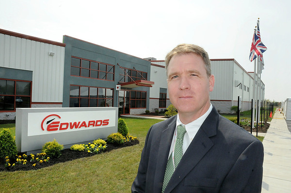 James Neiss/staff photographerSanborn, NY - Operations Manager Michael Brown stands in front of Edwards new north american headquarters in Sanborn.