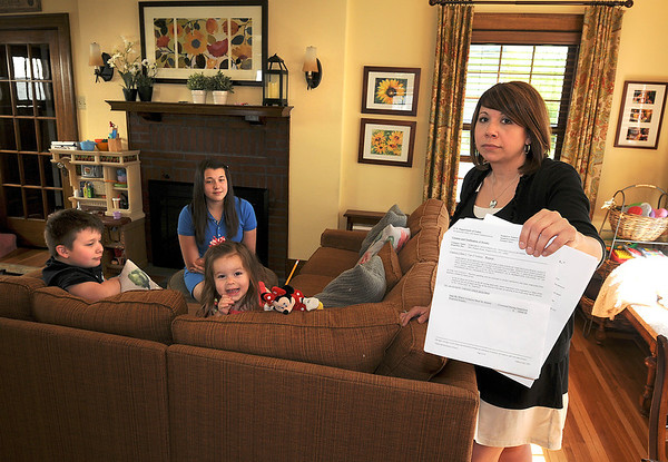 James Neiss/staff photographerNiagara Falls, NY - Mara Slipko-Neville's husband, Peter Neville, was killed in an industrial accident at Norampac. Saturday is the two-year anniversary of his death and his wife is still trying to get someone at the federal level to help her change the rules regarding workplace safety. The Neville family from left, Peter, 8, Rose, 14, Emma, 2 and Mara Slipko-Neville.