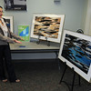 "James Neiss/staff photographerLewiston, NY -  Visual artist Paula Sciuk, with the American Cancer Society and VP of the Buffalo Society of Artists, shows off photos that are part of Fluid Culture, a lecture and public arts series at the Niagara Falls Power Vista organized by the Humanities Institute at the University at Buffalo. Sciuk, said her photographic installation explores an abstract view of local waterways around the Niagara Power Project and that these two photographs titled ""Deuterium,"" on the left, and ""Imbuere,"" at right, will be donated to Roswell Park Cancer Research Institute."