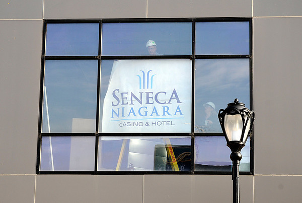 James Neiss/staff photographerNiagara Falls, NY - Workers hang a Seneca Niagara Casino & Hotel banner inside the Niagara County Community College Culinary Institute under construction, just before Seneca Nation of Indians representatives present a check in the amount of $375,000,  the first payment of the $1.275 million Seneca Gaming Corporation has pledged to the project over the next five years.