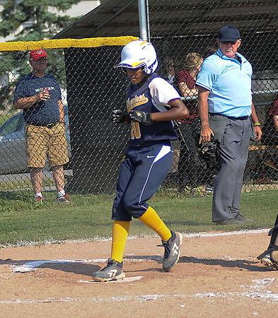 James Neiss/staff photographerNiagara Falls, NY - Niagara Falls girls softball player #20 Antoinette Polk makes a run during playoff game action against Orchard Park.