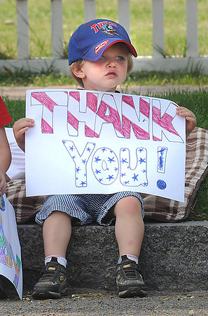 James Neiss/staff photographerLewiston, NY - Little Devan Barnwell, 2, gives thanks to those who gave the ultimate sacrifice for their country during the Lewiston Memorial Day parade on Center Street.