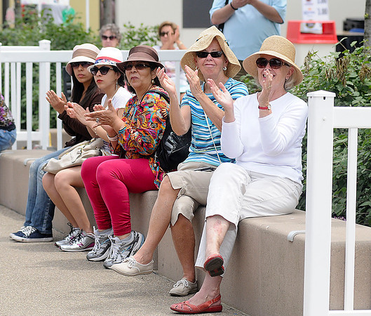 James Neiss/staff photographerNiagara Falls, NY - Hat wearing spectators, from left, Oriana Maldonado-Diaz, Tania Maldonado-Diaz, Marla Diaz, from Columbia, Pat McClain from Tonawanda and Mike Egan from Amherst, applaud the Buffalo Philharmonic Chorus on Old Falls Street, part of a Memorial Day Weekend concert lineup featuring 9 acts presented by Old Falls Street, USA.