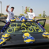 James Neiss/staff photographerNiagara Falls, NY - Niagara Falls seniors Andrew Dewitt, left, and Brandon Johnson show off their decorated ride after participating in the Senior Day parade.