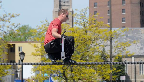 James Neiss/staff photographerNiagara Falls, NY - Nik Wallenda checks his balance during a practice session in May.