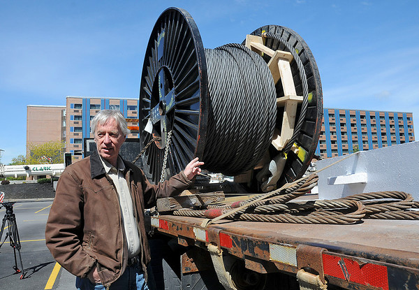 James Neiss/staff photographerNiagara Falls, NY - Project Engineer Peter Catchpole of Power Engineers in Indiana, whose company designed both the practice and event high wires, shows off a spool of 2 inch cable they will be using for the practice sessions at the Seneca Niagara Casino & Hotel, on the site of the old Lackey Plaza along 3rd Street. Wallenda is scheduled to begin practicing at 10:30 a.m. this Saturday.