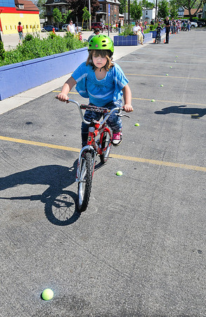 James Neiss/staff photographerNiagara Falls, NY - Young Victoria Ewing, 8, shows off her bicycle riding skills at a Bike Rodeo sponsored by the Niagara Falls Police Department at the Niagara Street School.