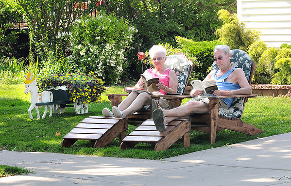 James Neiss/staff photographerNiagara Falls, NY - Thelma and Charles Livingston enjoy the warm sunny afternoon relaxing and reading a book in front of their Ontario Avenue home.