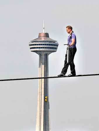 James Neiss/staff photographerNiagara Falls, NY - Daredevil high-wire walker Nik Wallenda passes Old Falls Street with the Skylon Tower as a backdrop during his last day of practice in front of the Seneca Niagara Casino, before his attempted walk across the falls scheduled for June 15.