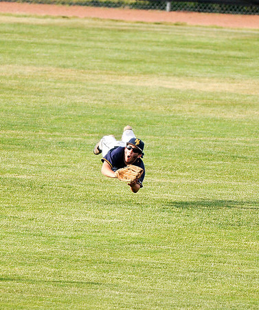 James Neiss/staff photographerNiagara Falls, NY - Niagara Falls boys baseball player #4 Joe Dilaura dives and catches a fly ball during game action in the Class AA semifinal against Orchard Park.