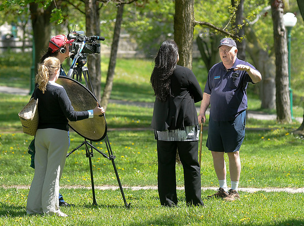 James Neiss/staff photographerNiagara Falls, NY - Local historian Paul Gromosiak is interviewed by a film crew from Voice Of America at Niagara Falls State Park. The crew was in town doing a documentary about Niagara Falls tourism, history and tourism in the future here for Pakistani television.