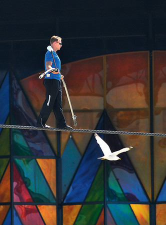 James Neiss/staff photographerNiagara Falls, NY - Daredevil Nik Wallenda walks among the birds in front of the Seneca Niagara Casino and Hotel during his morning high-wire practice session.