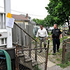 James Neiss/staff photographerNiagara Falls, NY - Deputy Director of Public Works John Caso, with the city's clean Neighborhood team, left, inspects a home with a run down yard on Simmons Avenue with Niagara Falls Police Officer Mike Corcoran after city inspectors left an order of cleanup for the owner.