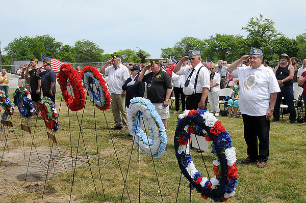 James Neiss/staff photographerNiagara Falls, NY - Members of local service organizations honor those who served their country and passed, during a Memorial Day service at Hyde Park next to the new Niagara Falls Veterans Memorial.