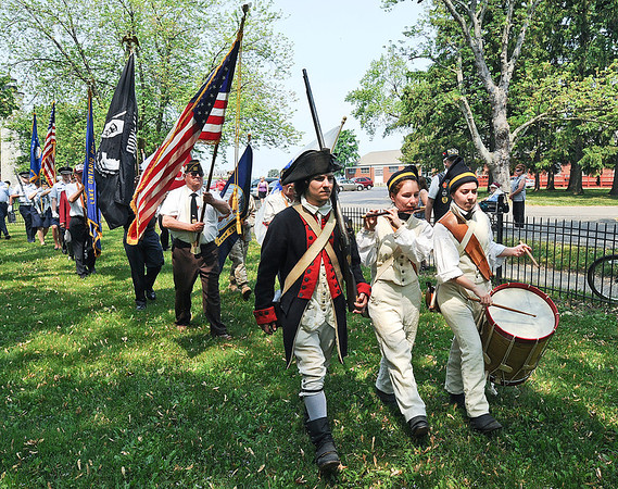 James Neiss/staff photographerYoungstown, NY - Members of the Old Fort Niagara Fife & Drum Corp., from left, Will Emerson, Suzannah Emerson and Lauren Agnello lead the honor guard during Memorial Day ceremonies at the War of 1812 Cemetery at Fort Niagara State park, sponsored by the Lake Ontario VFW Post #313 in Youngstown.