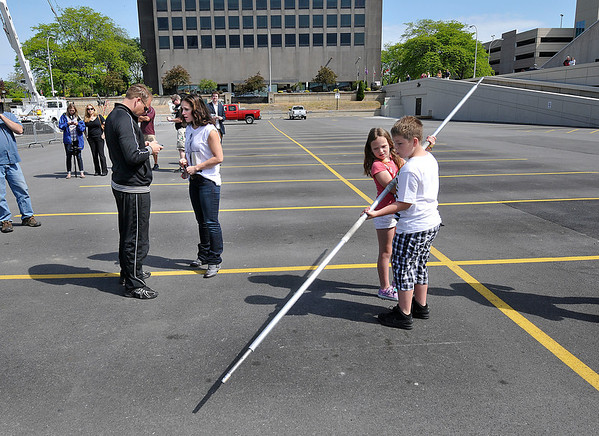 James Neiss/staff photographerNiagara Falls, NY - High-wire walker Nik Wallenda and his wife Erendira have a conversation as 2 of his 3 children Evita, 9, and Amadaos, 11, examine one of their fathers ballancing poles before the morning practice.