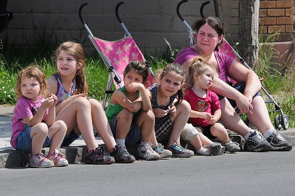 James Neiss/staff photographerNiagara Falls, NY - Nicole Niles, right, watches the Niagara Falls Memorial Day weekend parade from the curb along Pine Avenue with her daughters, from left, Courtney Niles, 4, Katelyn Pawlukovich, 9, Rachel Niles, 5, Marissa Garver, 8, Kayla Niles, 2, hiding in back, and Natalie Niles, 2.