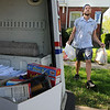 James Neiss/staff photographerNiagara Falls, NY - Niagara Falls letter carrier Chris Ferchen shows off some of the food he's collected along Ferry Avenue early in his rounds from those supporting the postal food drive on Saturday.