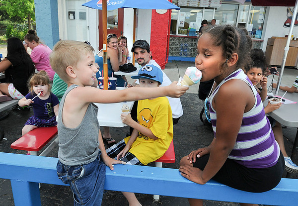James Neiss/staff photographerNiagara Falls, NY - Little Nolin Alexander, 5, had no problem sharing his ice cream cone with his cousin Lexia Edwards on a family outing to Porky's Hot Dogs on Hyde Park Boulevard Tuesday.