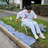 "James Neiss/staff photographerNiagara Falls, NY - Hattie Lowery doesn't let a hip replacement keep her from taking care of a little yard work in front of her Tennessee Avenue home. Lowery was placing old cloth strips over newly seeded grass. "" You do with what you have and do it till you can't no more,"" she said."